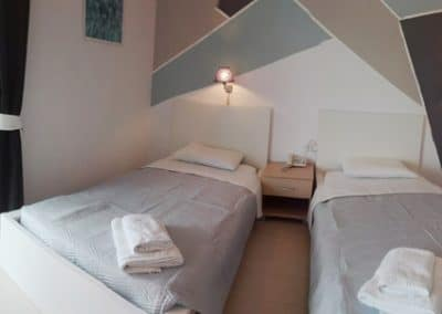 single beds in the apartment for two people